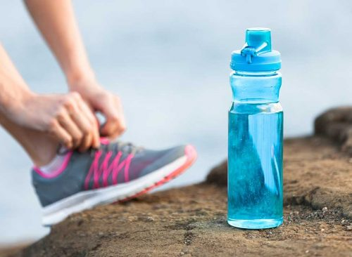 Water bottle and sneakers