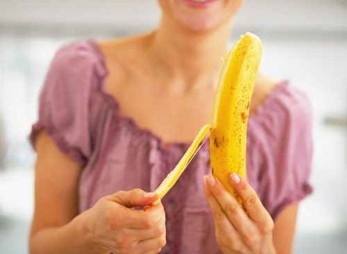 Woman peeling banana